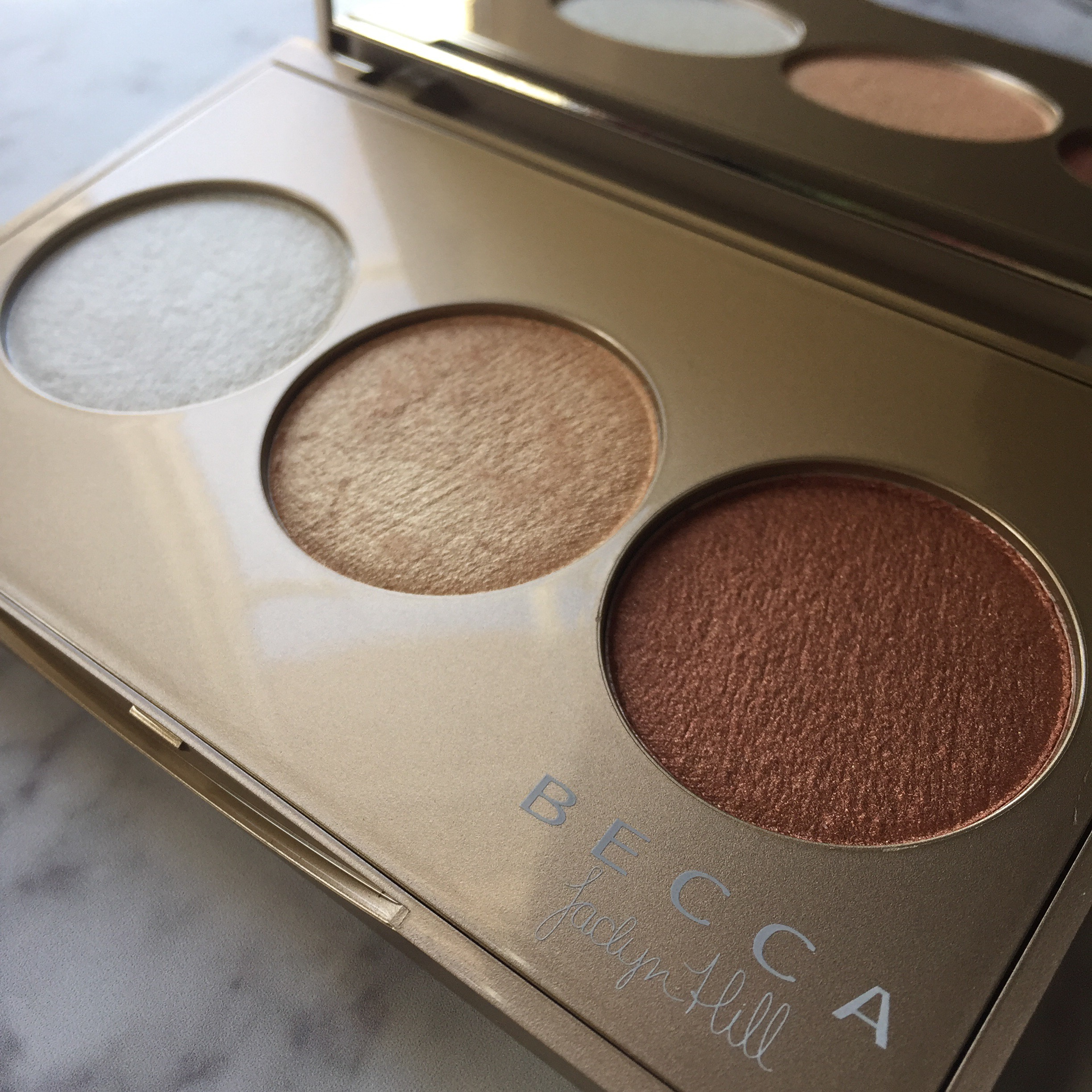 BECCA Shimmering Skin Perfector® Pressed Champagne Glow Palette featuring Champagne Pop x Jaclyn Hill