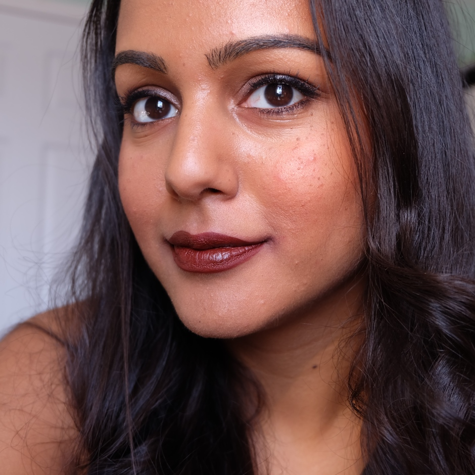 Huda Beauty Liquid Matte Lipstick in Vixen on nc45 dark skin